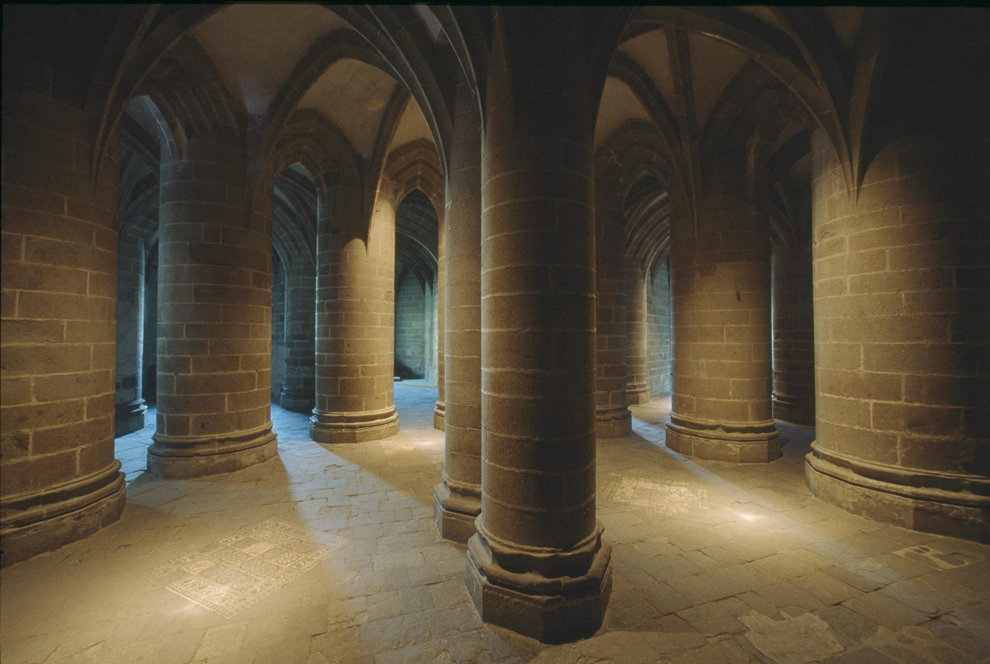 "The site was inscribed twice on the World Heritage List. First in 1979, under the title ""Mont-Saint-Michel and its Bay,"" and then in 1998 as the ""Pilgrim's Way to Santiago de Compostela in France."" Pictured: the Crypt of large pillars. – © Abbaye du Mont-Saint-Michel / CMN"