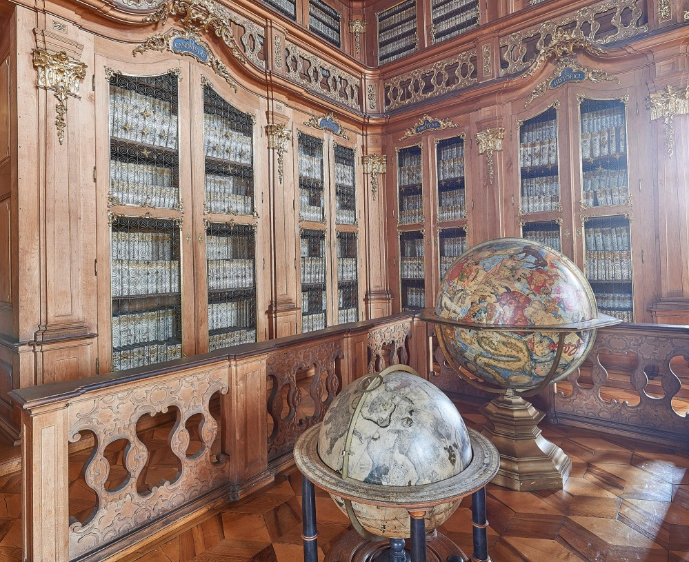 The Palace Library contains over 61,000 volumes of books 436 manuscripts, and 172 incunabula. The purpose of the collection was to bring together all the knowledge of the world to become a source of spiritual and artistic inspiration. – © Tomas Vrtal