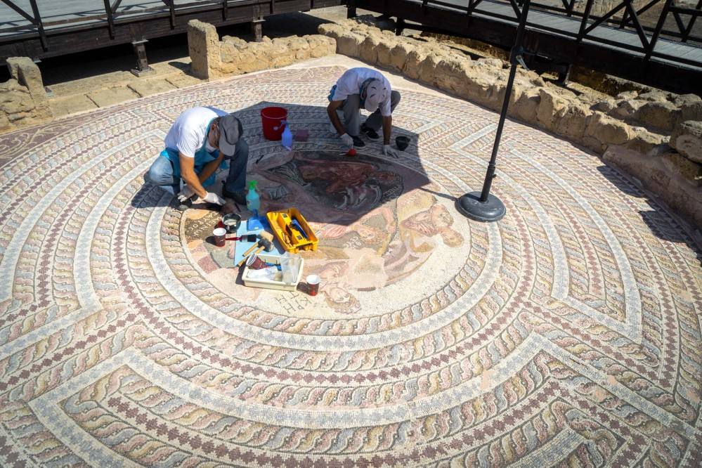 To protect the intricate floor mosaics at the Kato Pafos Archaelogical Site, conservation works are systematically conducted. – © Michael Turtle