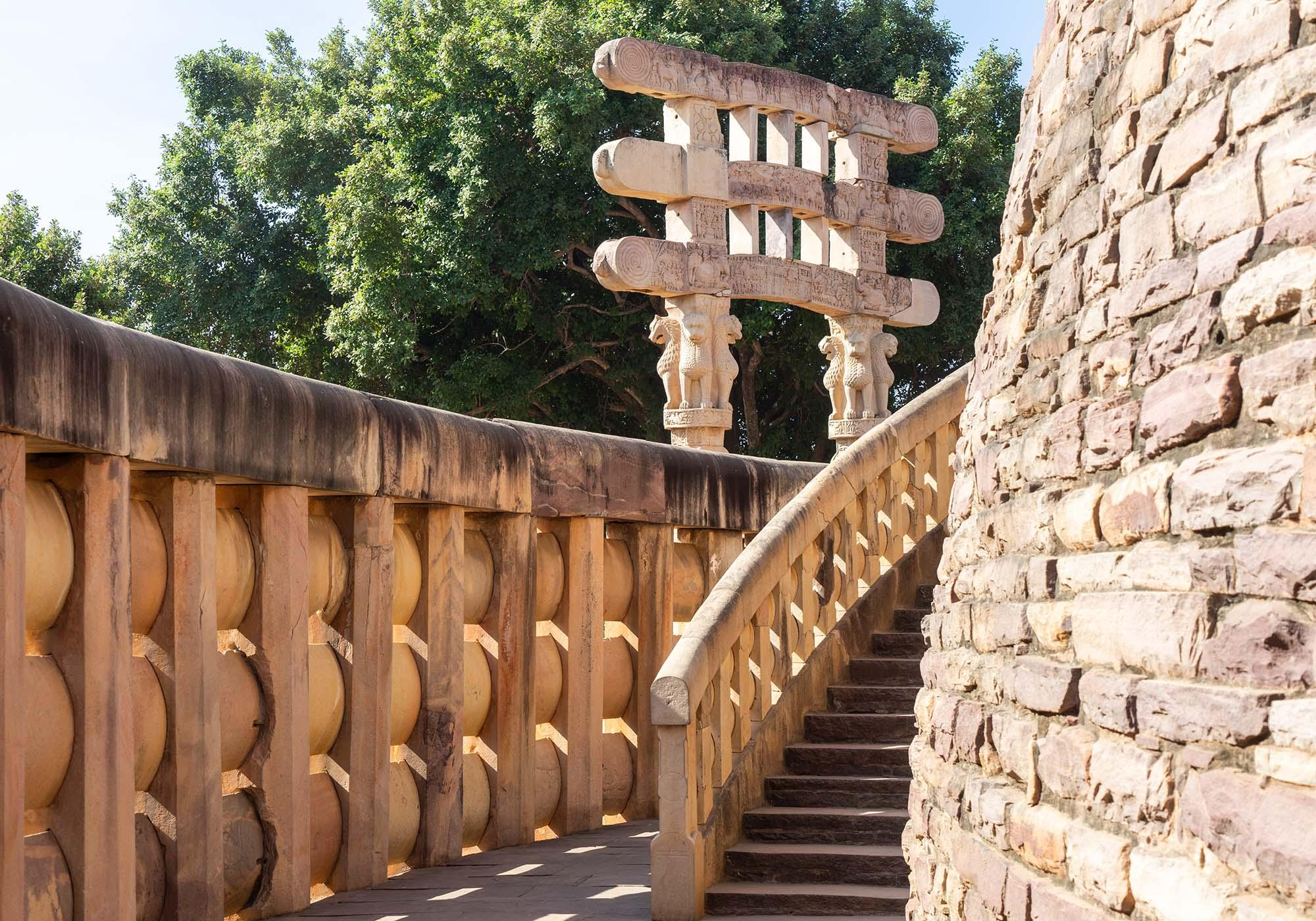 The intricately-carved gateways and the stone balustrades around the stupa were added in the years after Emperor Ashoka's death. – © Michael Turtle