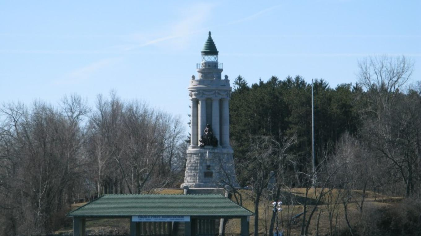 Seen from the water, the Crown Point Memorial Lighthouse soars above you. – Courtesy of Cathy Frank