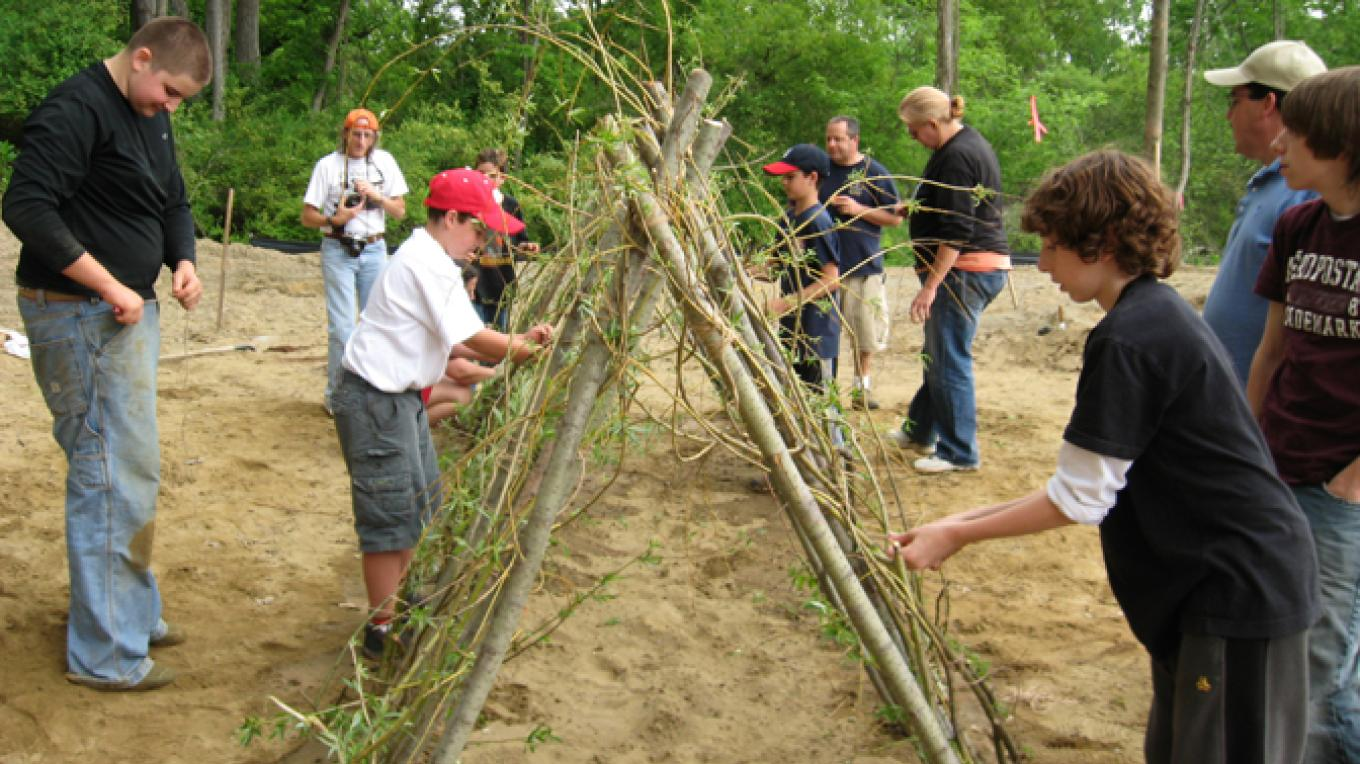 More Scouts build a living tunnel.