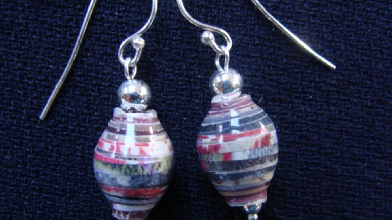 "From the ""Evergreen"" line this pair of ""Pine"" Earrings consists of beads made from junk mail. – Winefred Martin"