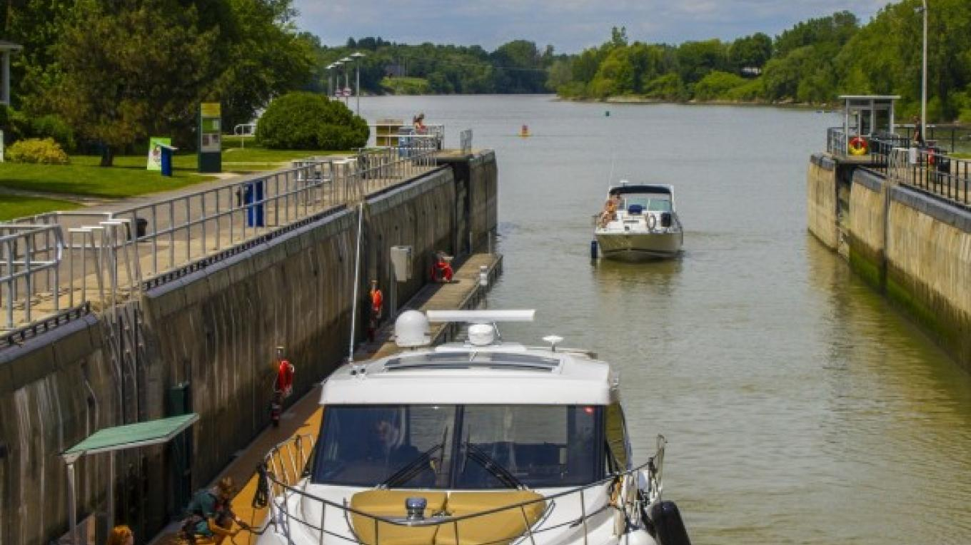 Boats entering the lock at Saint-Ours National Historic Site. – Parks Canada