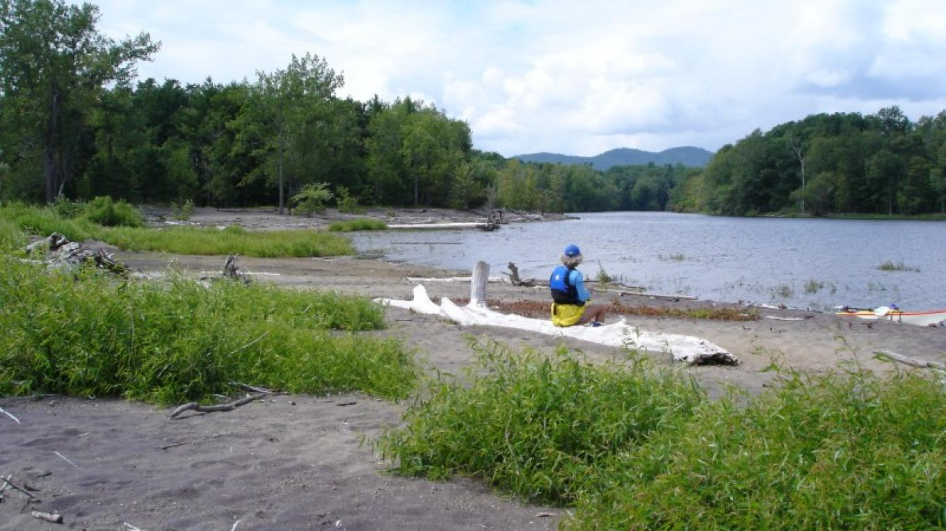A paddler enjoys rest and the view along the Boquet River. – Courtesy of Cathy Frank, in A Kayaker's Guide to Lake Champlain.