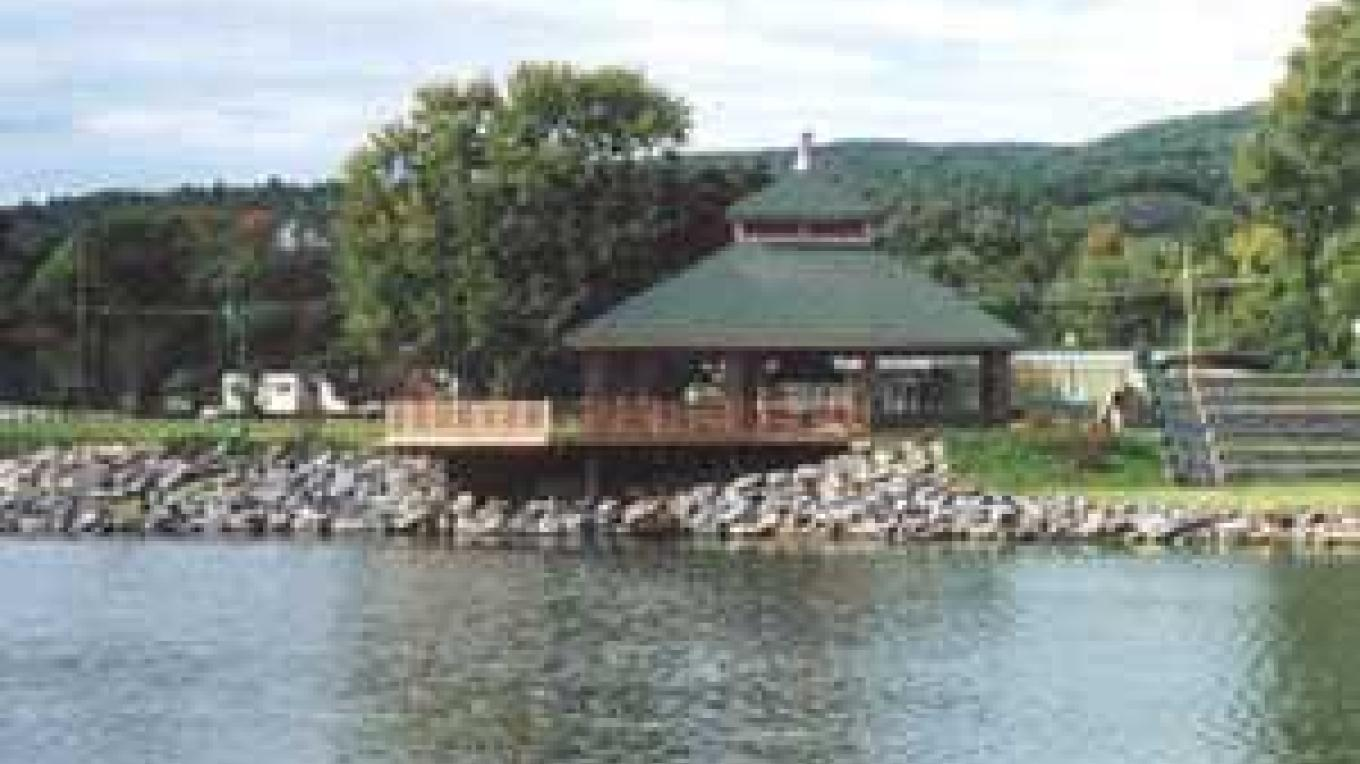 Shot of the Whitehall Canal Harbor Park Visitor Center taken from the canal. – NYS Canal Corp