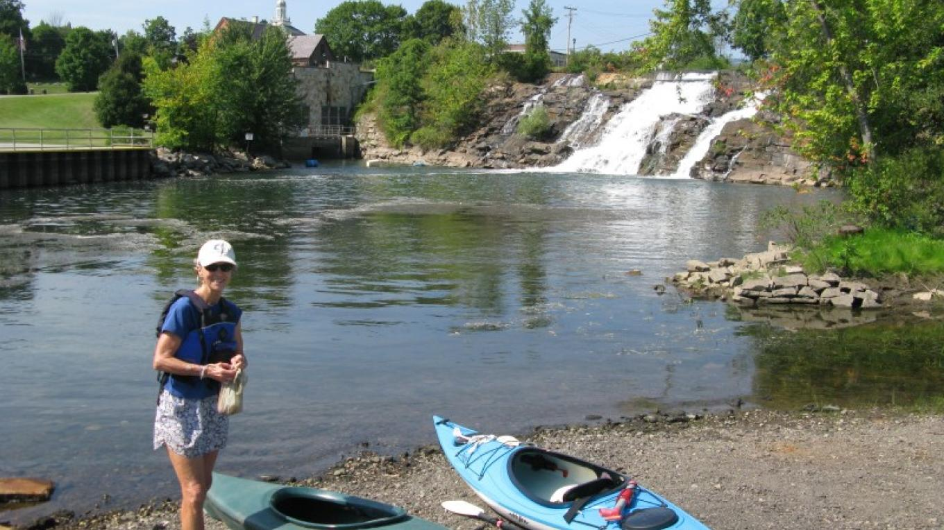 Launching kayaks against the backdrop of Bicentennial Falls. – Courtesy of Cathy Frank, in A Paddler's Guide to the Champlain Valley