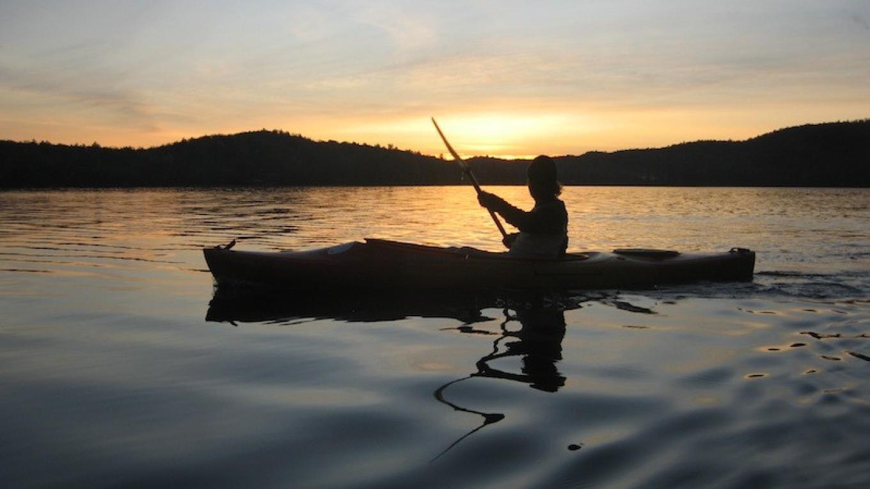 Lone Kayaker at Sunset – David Webb