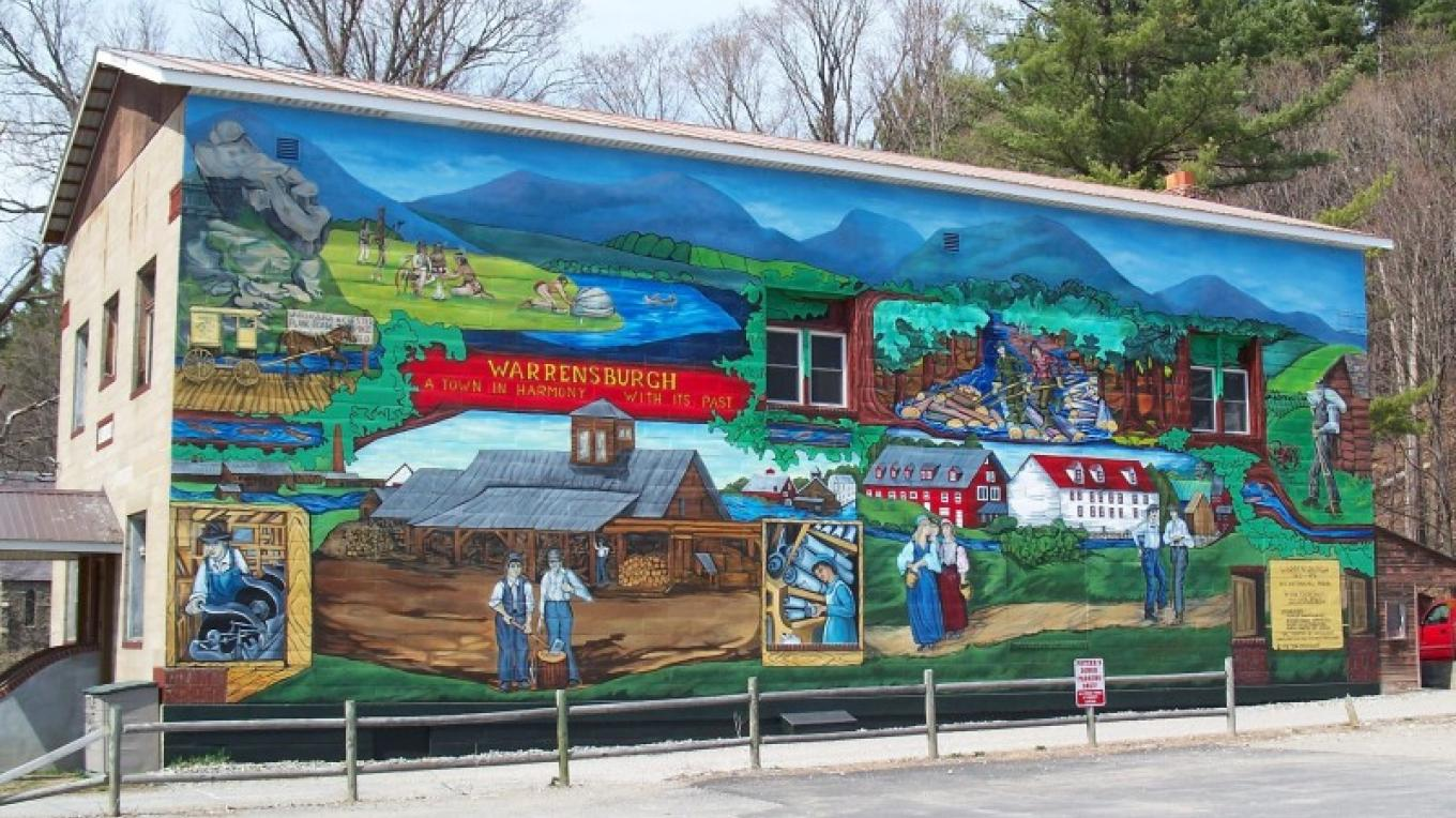 The 70-foot Warrensburgh Bicentennial Mural graces the side of the Museum of Local History.  Both portray the settlement and industry of this historic town, founded in 1813. – Steve Parisi