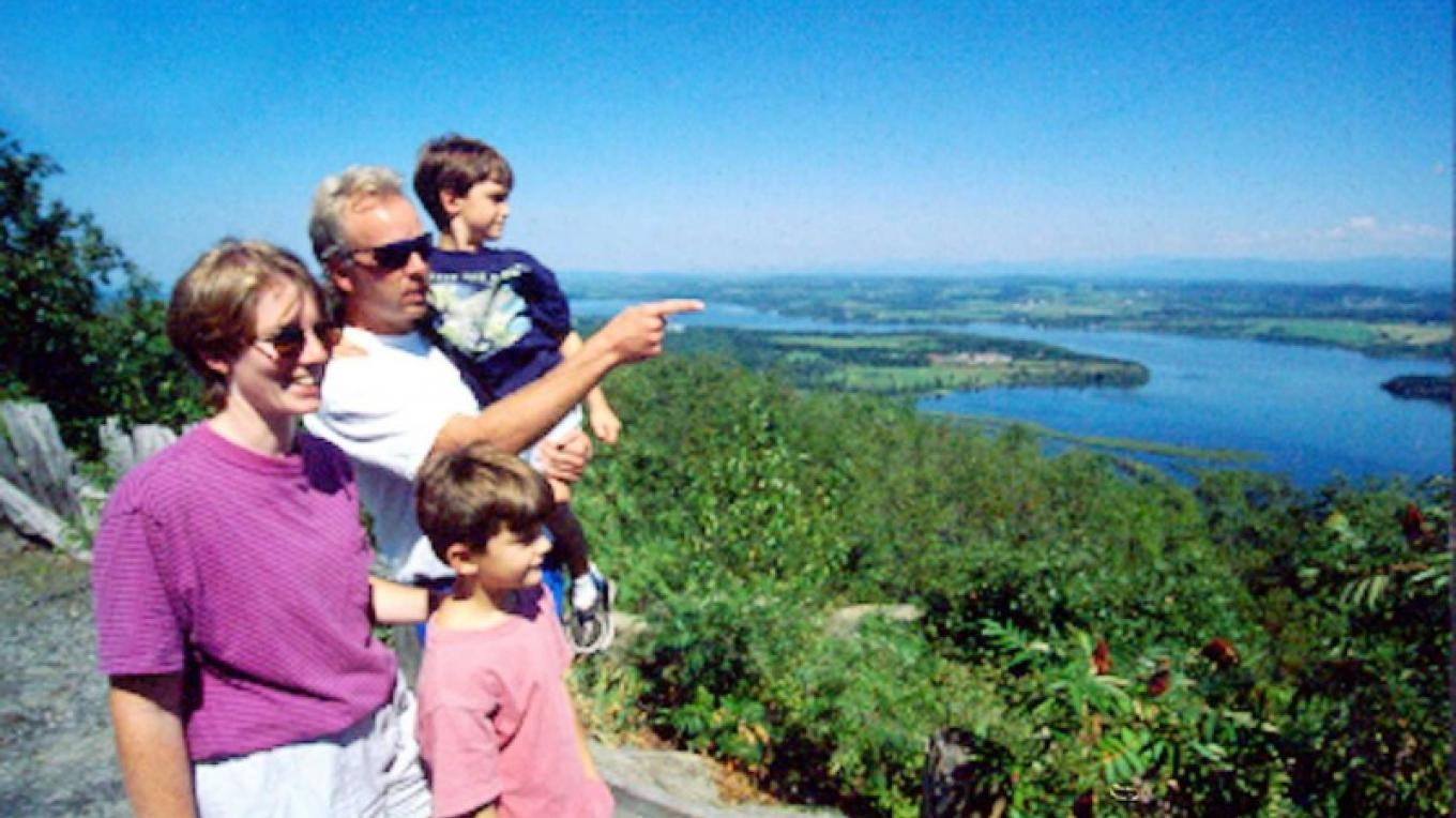 people looking east from atop Mt. Defiance in Ticonderoga – Lake Placid/Essex County Visitors Bureau