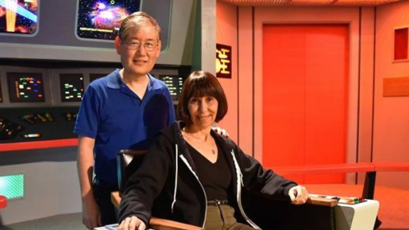 Denise and Michael Okuda On STar Trek Tour Bridge Set. – Star Trek Tour staff