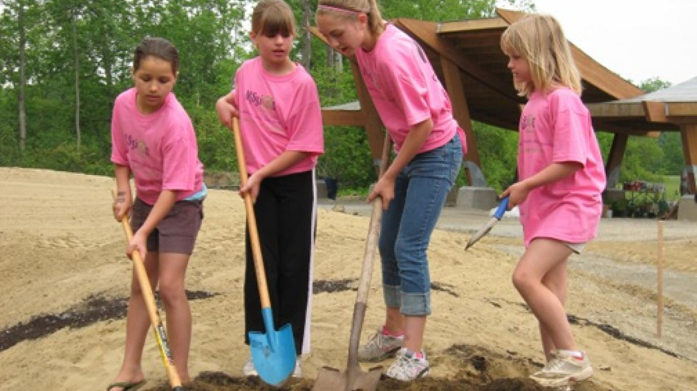 Scouts help out in the Play Garden.