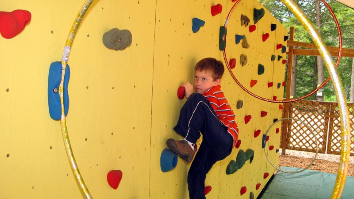Activities.  Try one of our two bouldering walls.  This is the Cave Kid wall or try our more demanding Caveman wall. – Greg Beckler