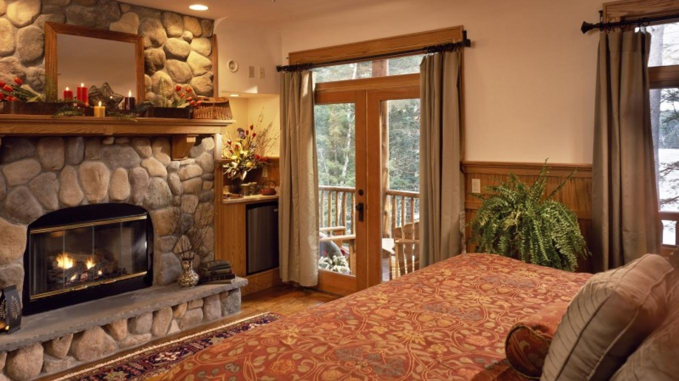 """Our guest room """"Oak"""" with king-size bed, fireplace, lakeview private porch, steam shower, and jaccuzzi. – Randall Perry Photography"""