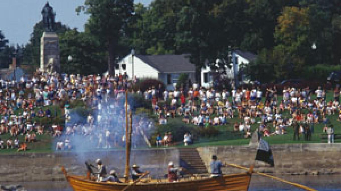 Photo of Battle of Plattsburgh reenactment involving boat – Plattsburgh-North Country Chamber of Commerce