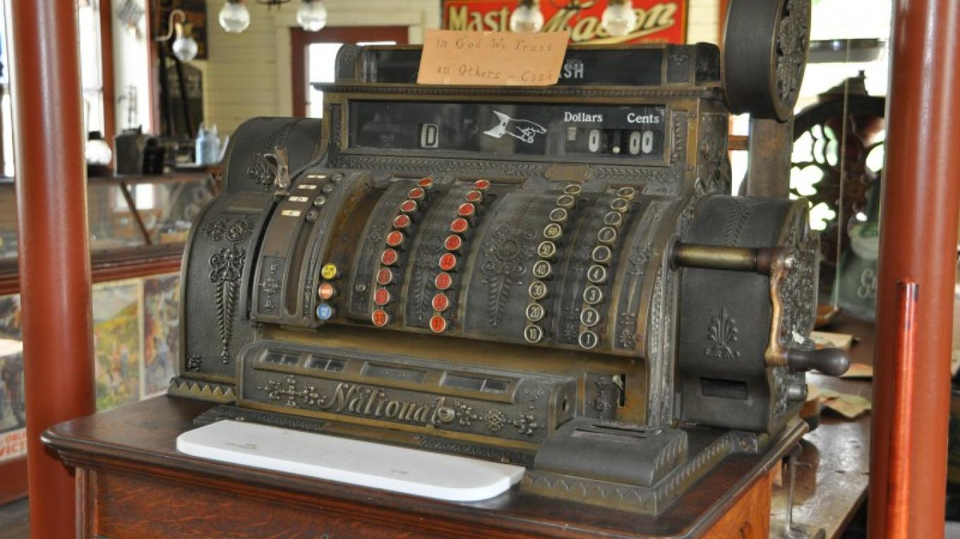 "The old cash register from Hodge's General Store c. 1890. A small sign reads ""In God we trust; all others Cash."" – Heather Darch"