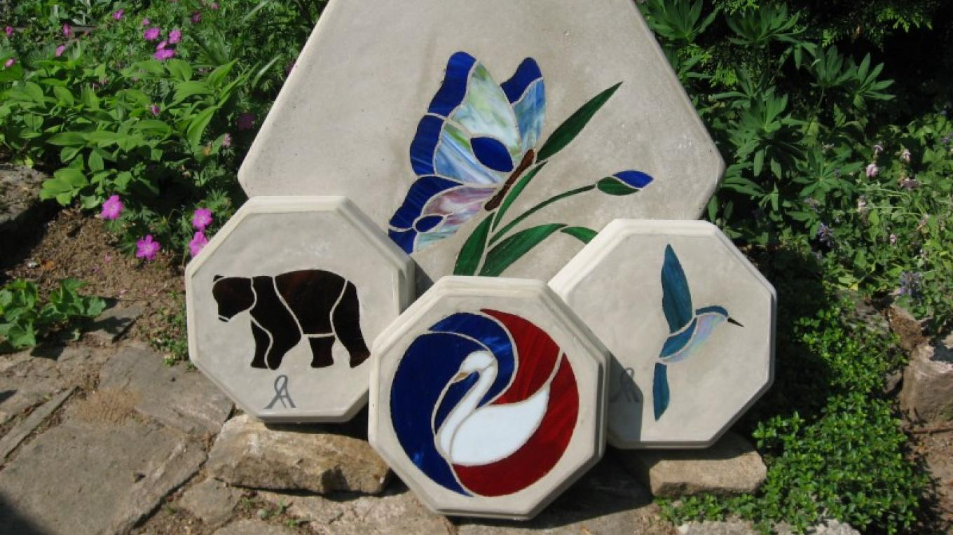 One of the many designs of the larger Stained Glass Stepping Stones and 3 of the smaller stones – Winefred Martin