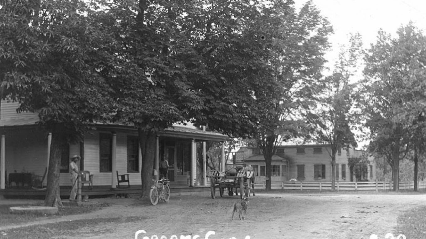 Postcard view of Grooms Tavern by Parker Goodfellow, c. 1910, note the photographers motorcycle parked by the building. – Parker Goodfellow