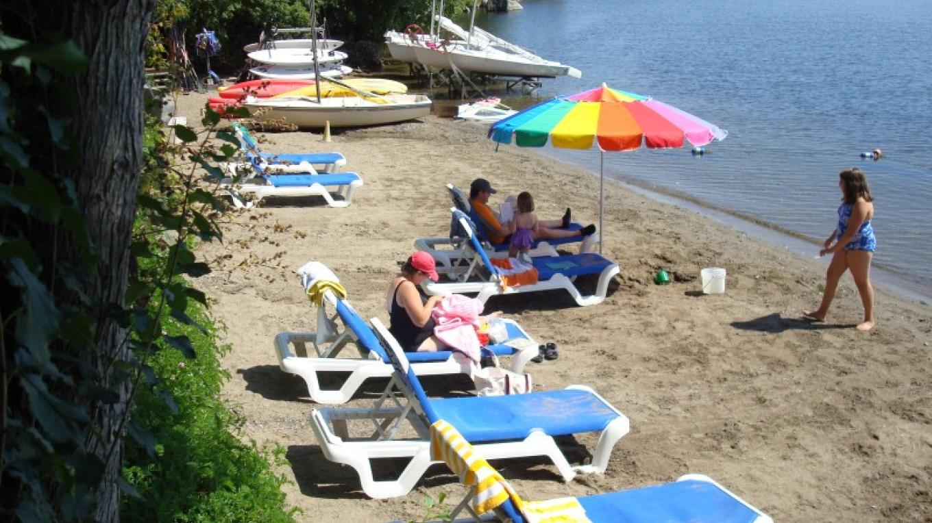 Guests enjoy 100 feet of sandy beach, unusual for rocky Lake Champlain, Sit back, relax and enjoy! – Waldemar Kasriels