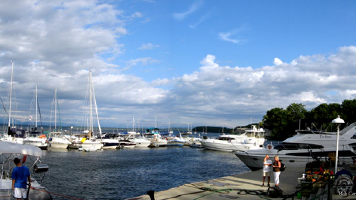 Marina service dock in foreground; marina store entrance, with boats on front floating dock in distance. – Bob Carroll
