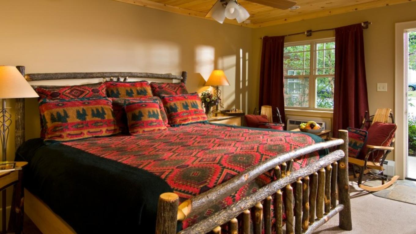 "A ""standard King"" guest room with king-size bed, flat screen tv with dvd, private bath, cd player. Some Standard Kings have a walk-out back porch or a gas-woodstove."