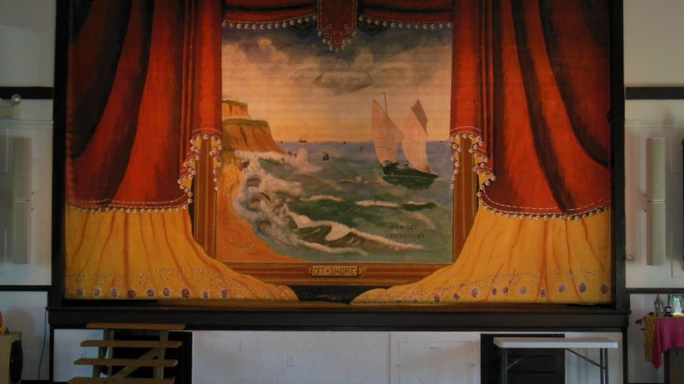 Main stage with historic painted curtain, recently refurbished. – Andy Buchanan