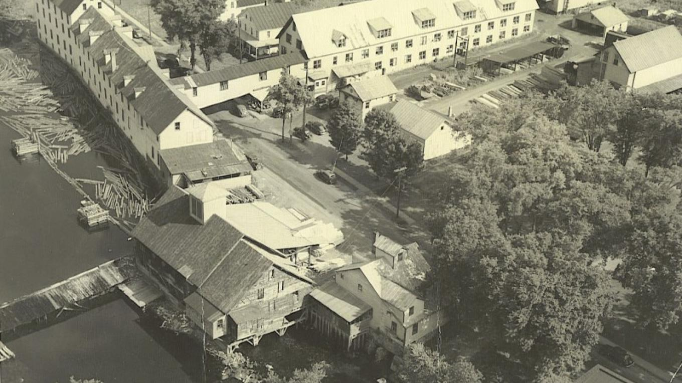 View of Schroon River mill district, with 1824 sawmill & grist mill, 1890s shirt factory. Photo c.1930s. – unknown