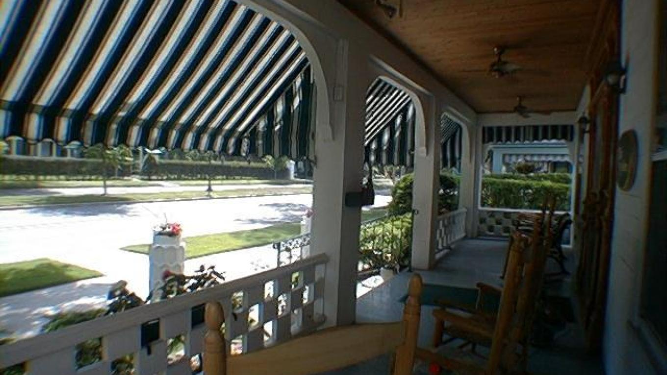 Front porch of the Six Sisters Bed and Breakfast. – Innkeeper