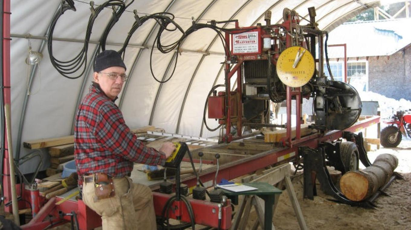 Gary at the controls of the saw mill – Winefred Martin