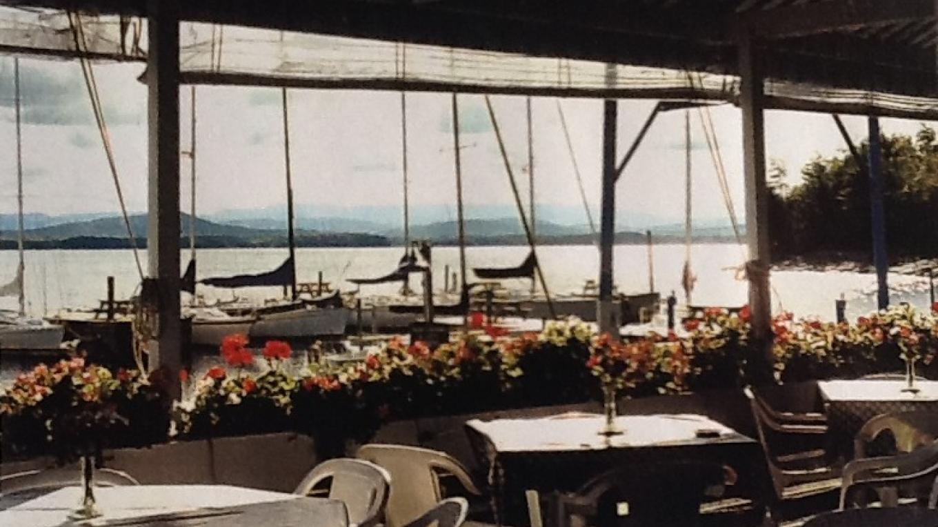 View of the Essex Shipyard and Lake Champlain from the outside deck at Chez Lin & Rays – Ray Faville