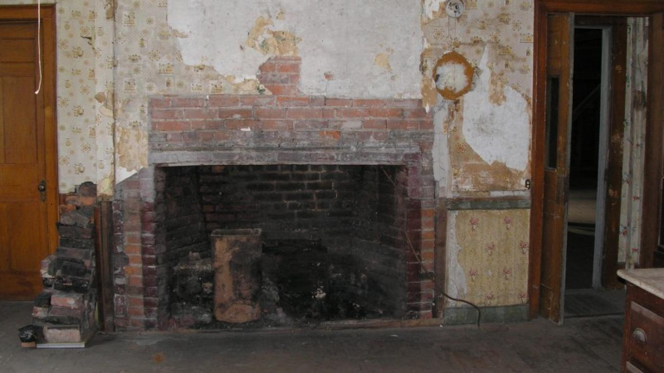 Fireplace discovered during restoration. – unknown