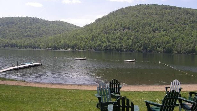 The beach on Thirteenth Lake – Garnet Hill Lodge