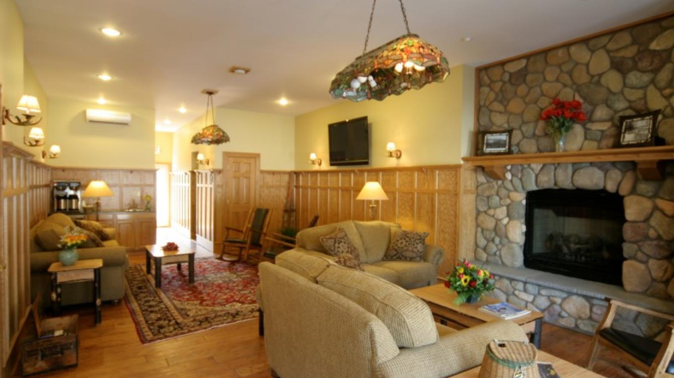 The Great Room is a nice common gathering area for the guests complete with a large fireplace and a large flat screen tv.