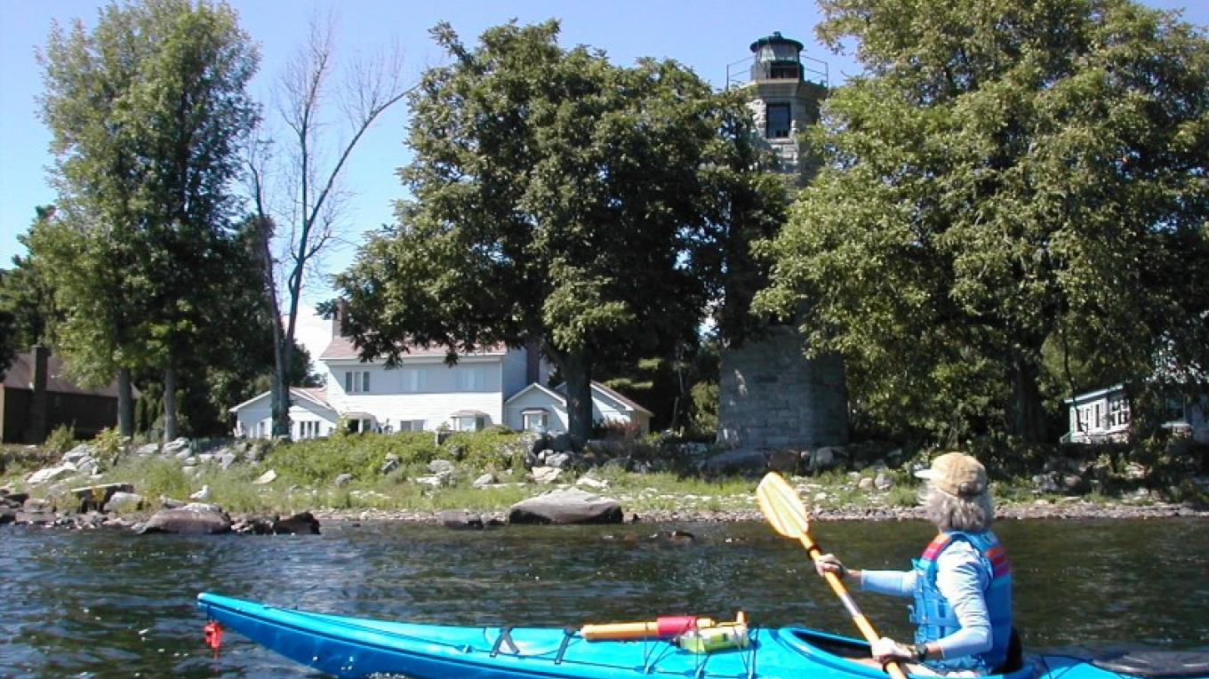 Paddling by the lighthouse. – Courtesy of Cathy Frank