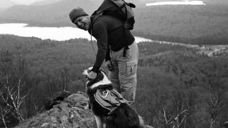 David Webb with Ben atop Chimney Mtn – Dana Romanoff