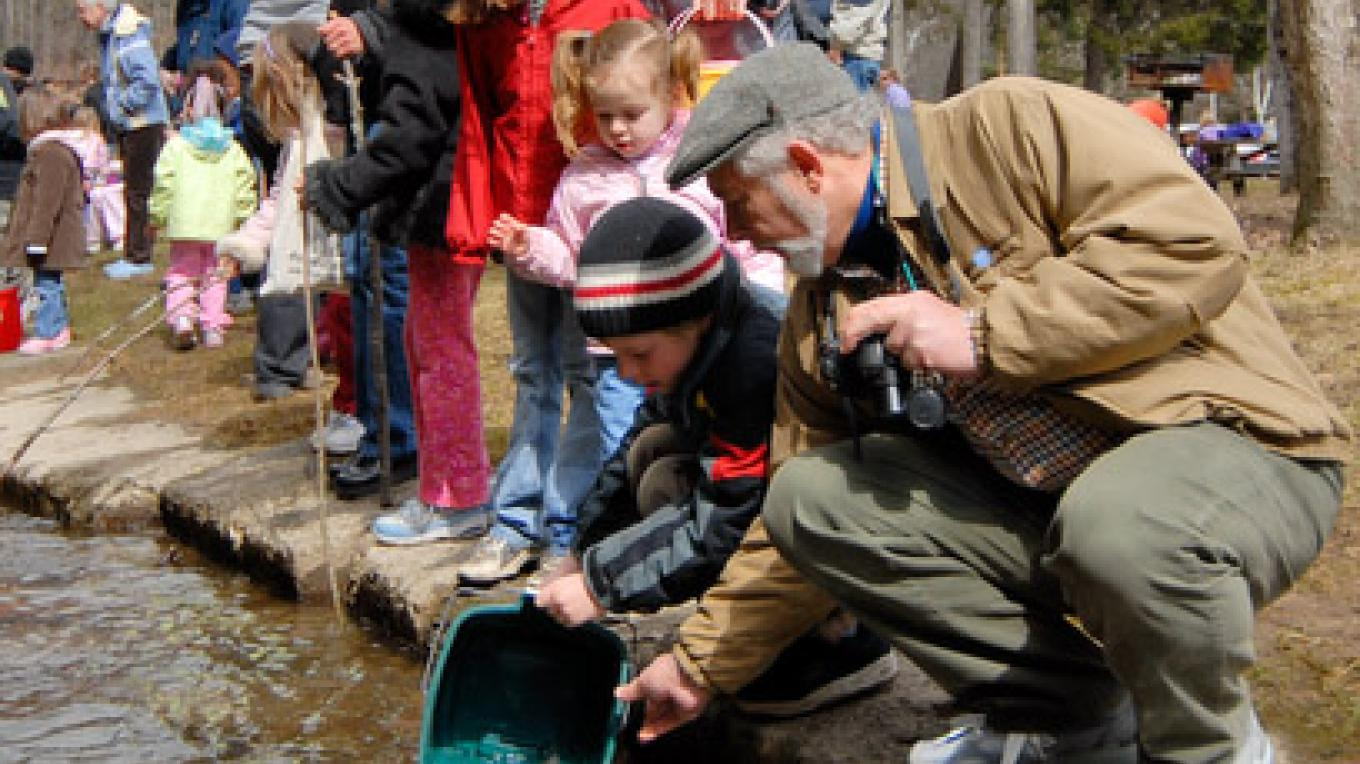 Children releasing trout in the Saratoga Spa State Park stream