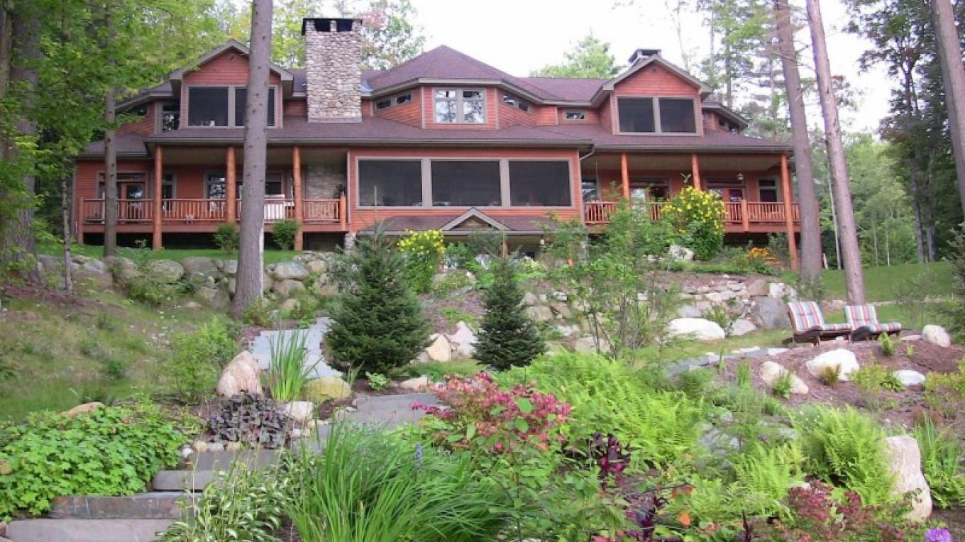 The lakeside of the lodge; walk down to the water through the beautiful perennial gardens to the boathouse or firepit.