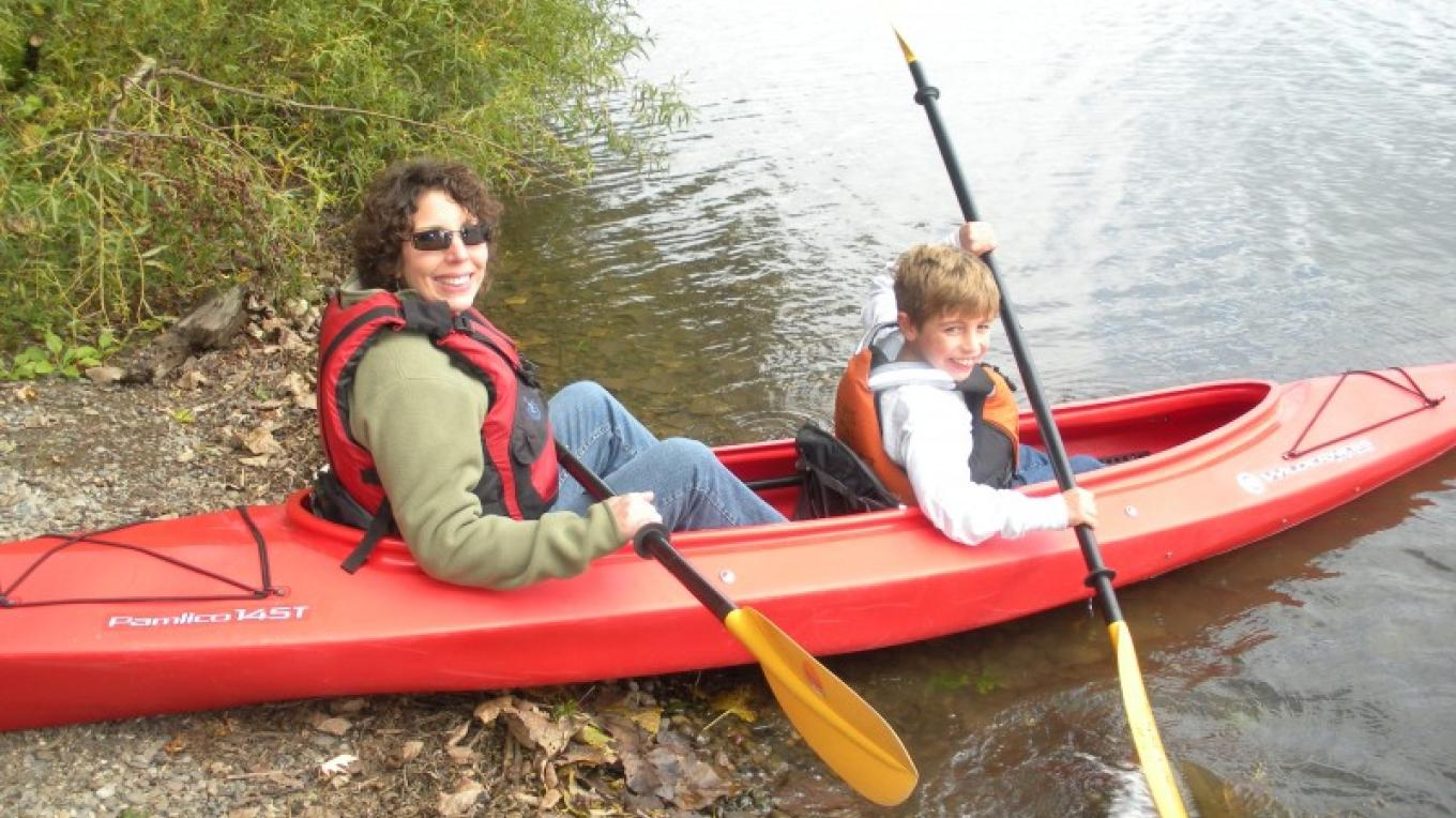 Kayak launching from preserve during community event – Myla Kramer