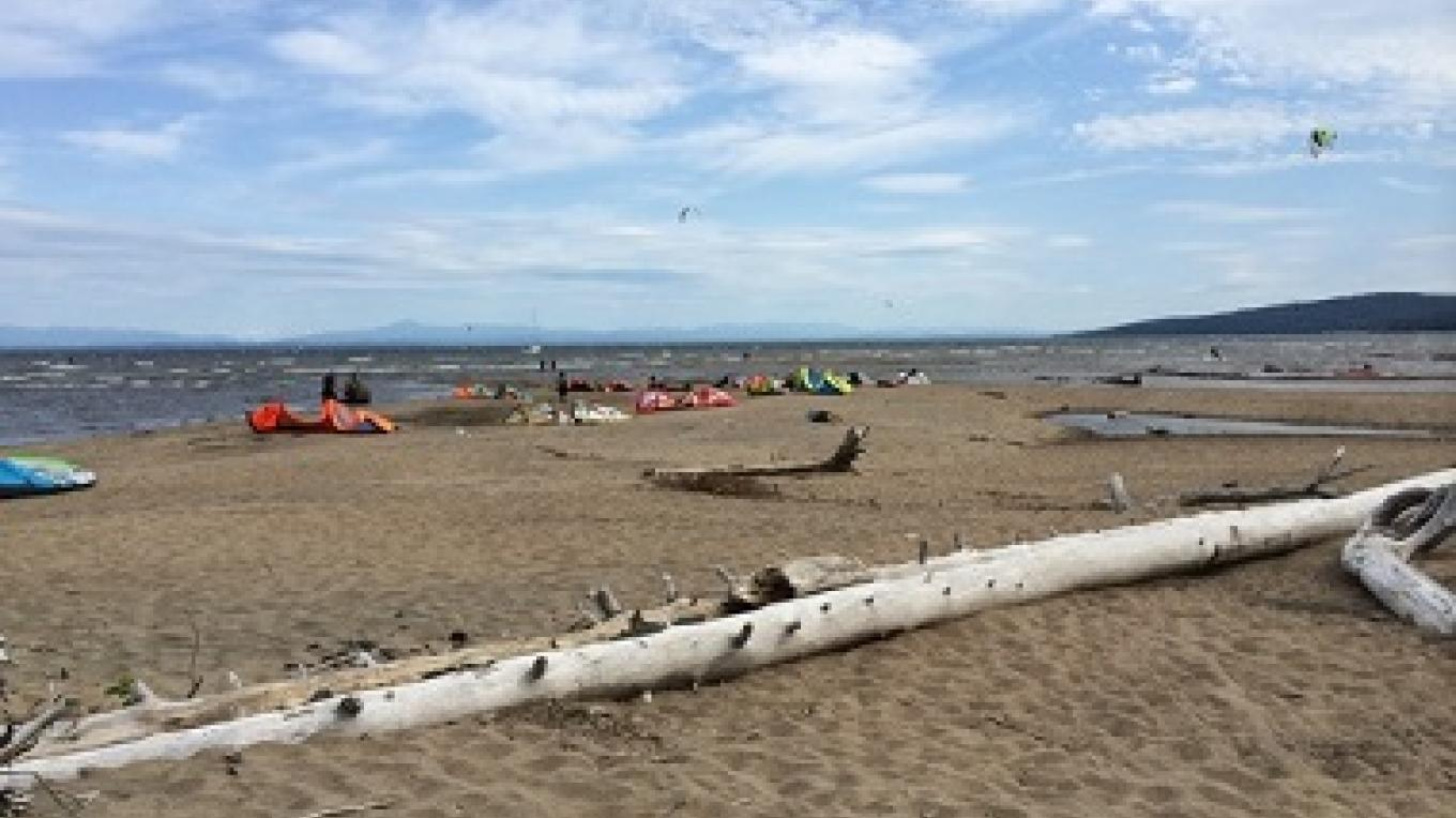 Ausable Point Campground protrudes from Route 9 into Lake Champlain and offers a shoreline of natural sand. – NYS DEC