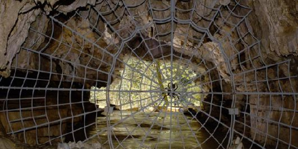 The famous historic Spider Web gate guards the entrance to Crystal Cave – Provided by the Sequoia History Association