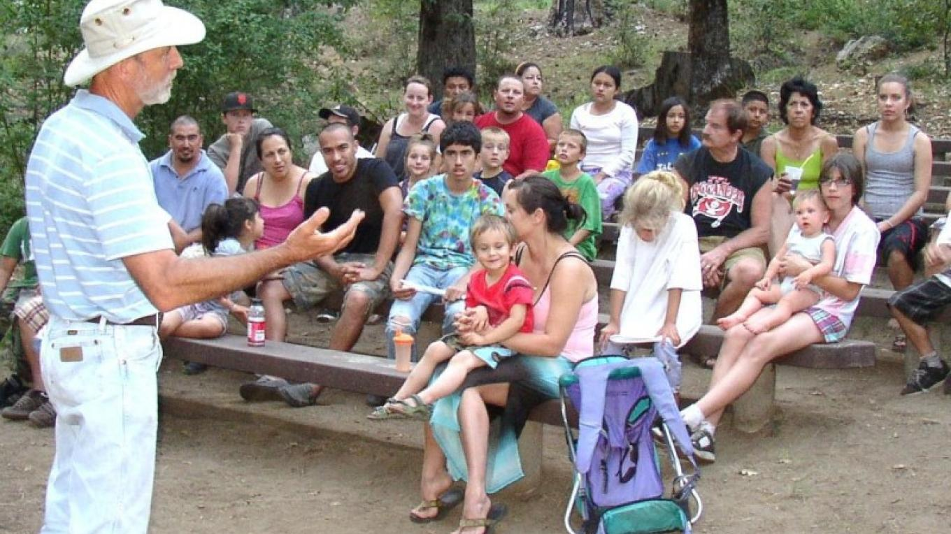 Mike Sutton delivers his interpretive program Creepers & Sneakers at the amphitheater at Wakaluu Hepyoo Campground. – Mike Needs