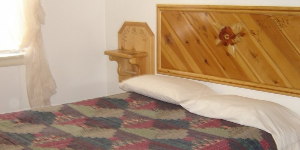 Each room is accented with custom wood designs by local artist, Red Bud – Carla Thorn