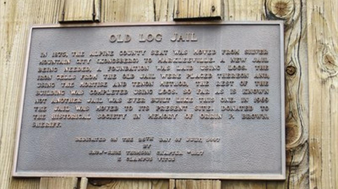 The Snow-Shoe Thomson Chapter #1827 of E. Clampus Vitus dedicated the Old Log Jail plaque in 1997. – www.waymarking.com