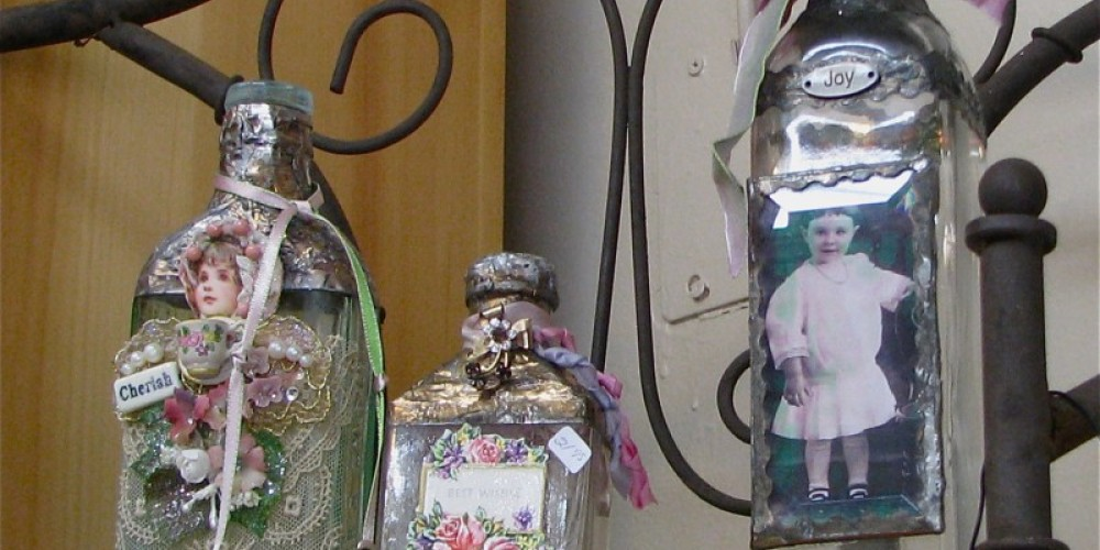 Antique bottles, many from the Gold Rush era, are hand decorated with diverse items. – Karrie Lindsay