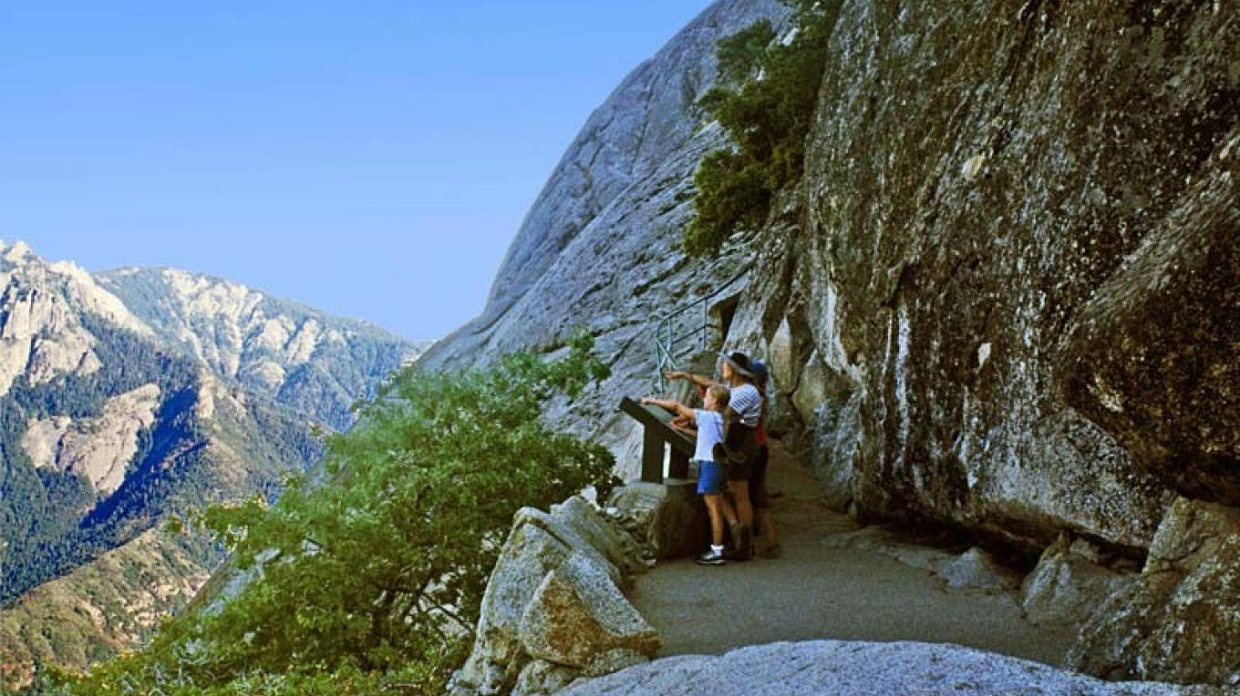 Park visitors gain excellent views of the Middle Fork of the Kaweah Canyon from the Moro Rock stairway. – NPS/Rick Cain