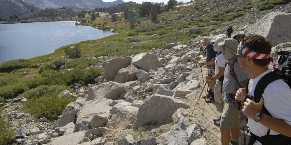 Backpackers pausing to enjoy the scenery along the John Muir Trail. – Kurt Wedberg