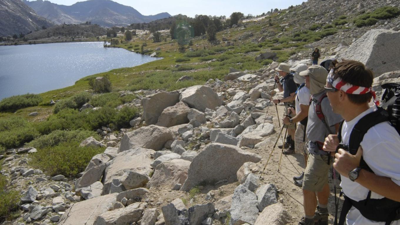 Backpackers pausing to enjoy the scenery along the John Muir Trail. – Kurt Wedberg