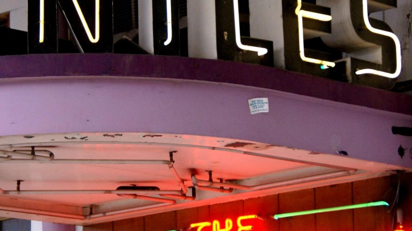 This neon sign is at the entrance of the Round-up Room bar. – Lorissa Soriano