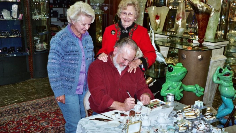 Art Walk patrons enjoy a demonstration at the Golden Swann. – Ken Underwood