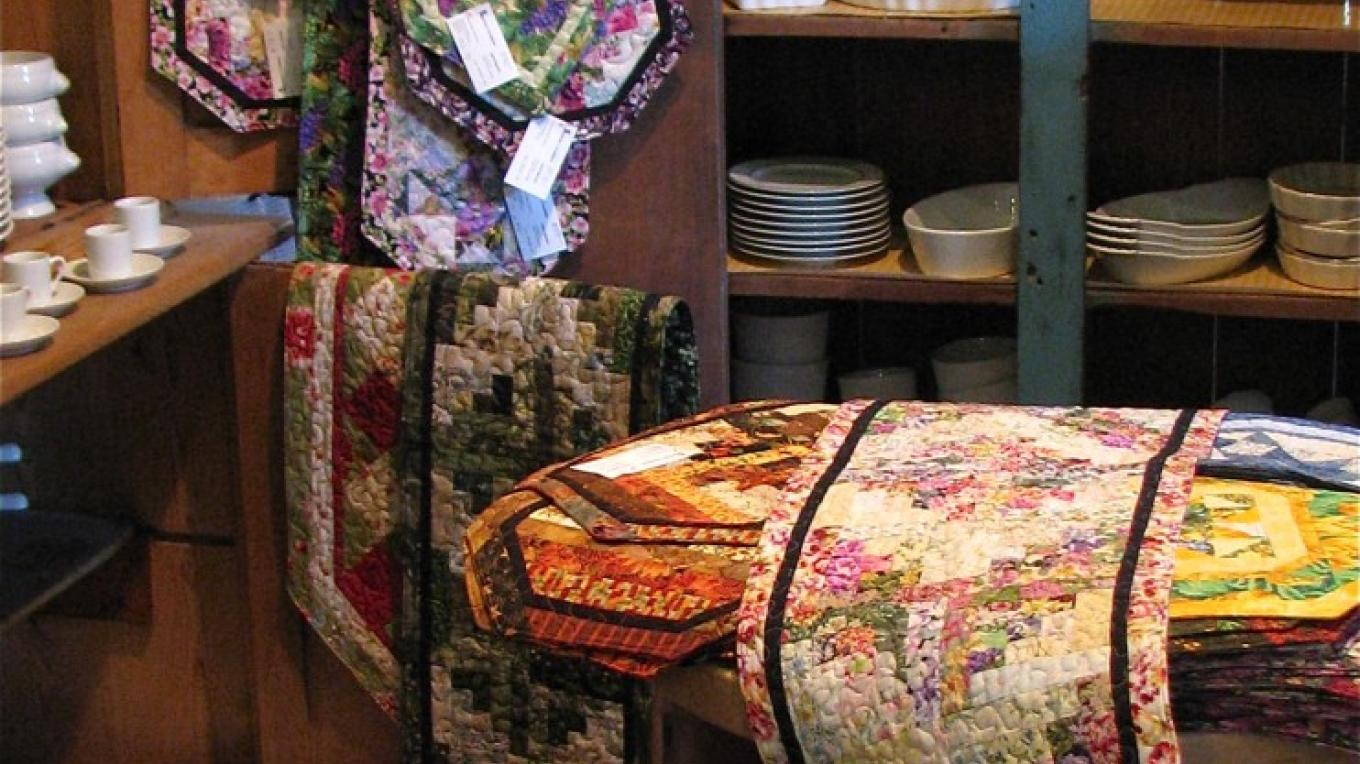 Quilted items by Amador City resident Janet Spencer show a life time of quilting skill. Table runners brighten any table. White ware is perfect on them. – Karrie Lindsay